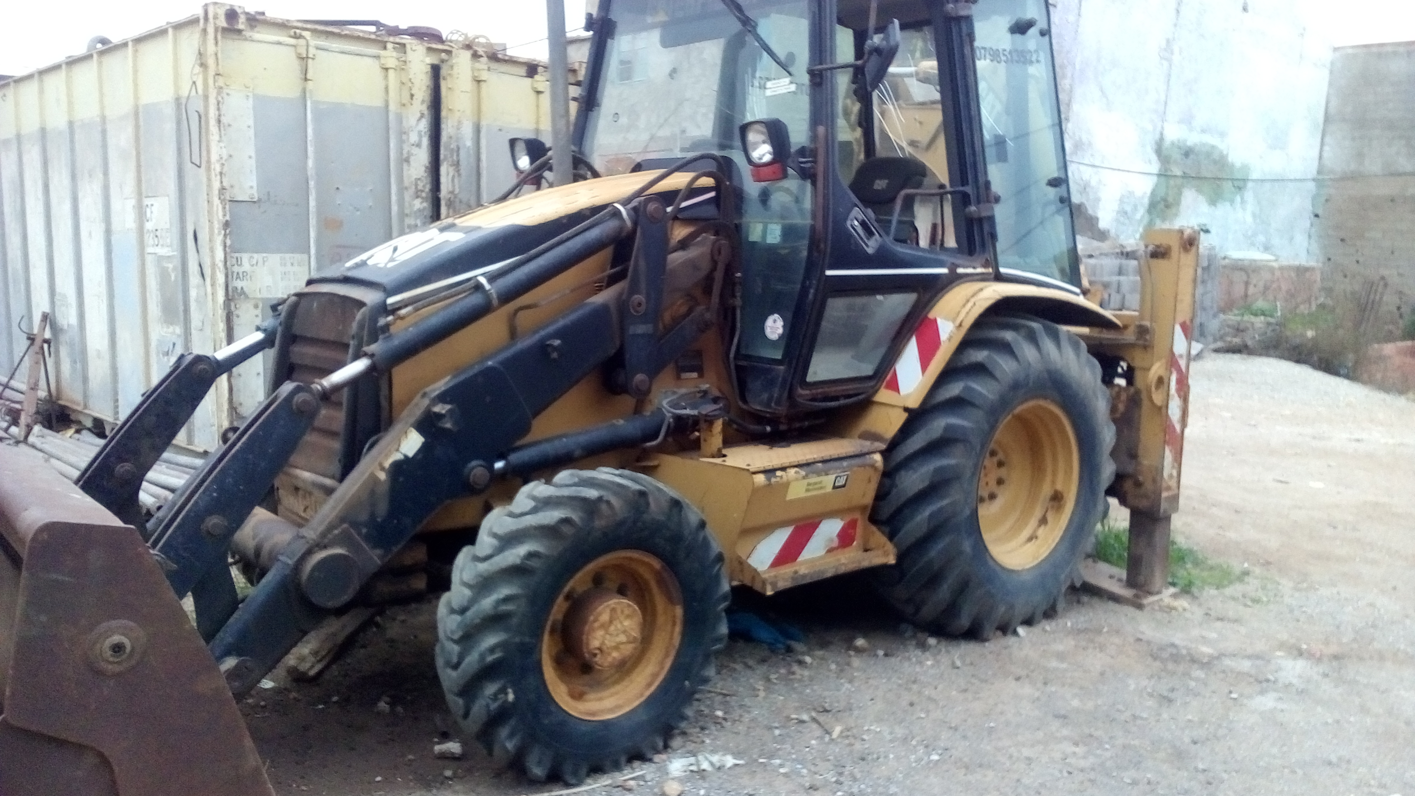 retro chargeur caterpillar 428D ouedkniss